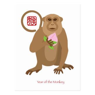 Mono chino del Año Nuevo con el melocotón de la Tarjeta Postal