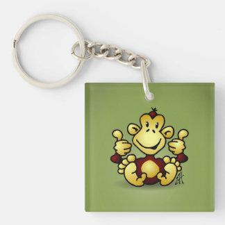 Mono con cuatro pulgares para arriba llaveros