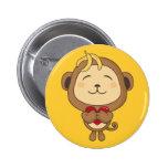 Mono con el botón del corazón pin