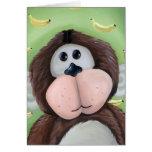 Mono con el fondo del plátano felicitacion