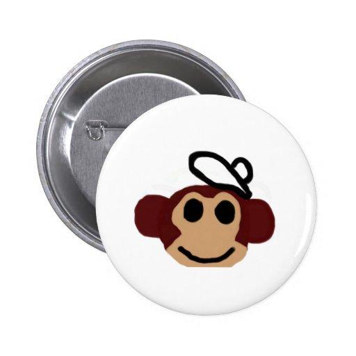 Mono con el gorra pin