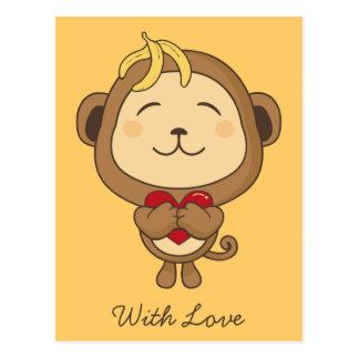 Mono con la postal del amor