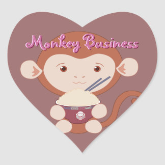 Mono con los pegatinas del corazón del cuenco de pegatina en forma de corazón