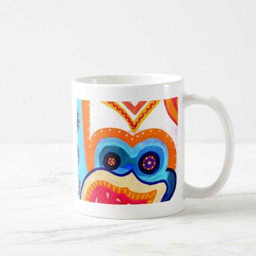 Mono con un gorra taza de café