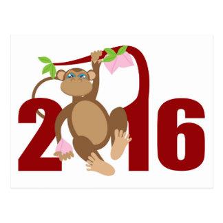 Mono de 2016 chinos en árbol con las frutas de la postales