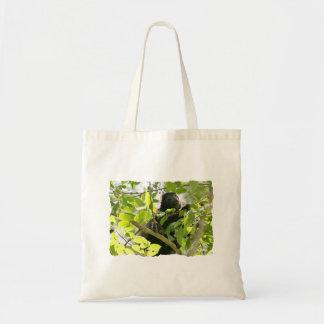 Mono de chillón en la foto de la selva bolsas de mano