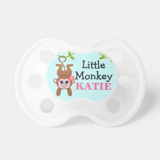 Mono de la niña chupete de bebe