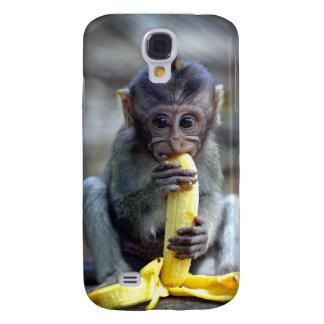 Mono de macaque lindo del bebé que come el plátano carcasa para galaxy s4