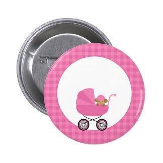 Mono del bebé en un carro en rosa pin