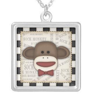 Mono del calcetín colgante cuadrado