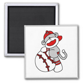 Mono del calcetín con las camisetas y los regalos  imanes de nevera