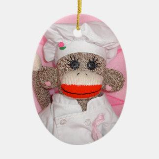 Mono del calcetín para el ornamento oval de la adorno navideño ovalado de cerámica