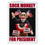 Mono del calcetín para la tarjeta del presidente n