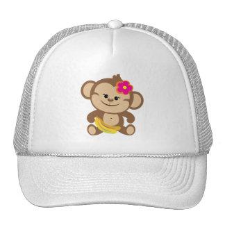 Mono del chica con el plátano gorras de camionero