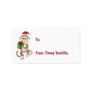 Mono del dibujo animado con el regalo de Navidad Etiqueta De Dirección