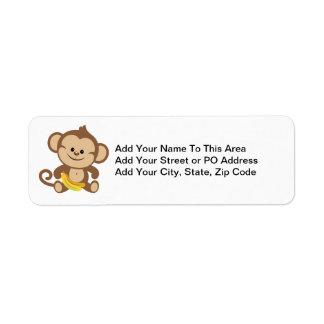 Mono del muchacho con el plátano etiqueta de remite