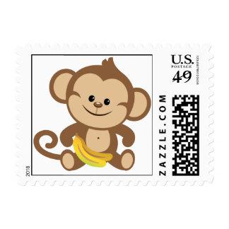 Mono del muchacho con el plátano envio