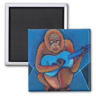 Mono del orangután del guitarrista de los azules d iman de frigorífico