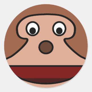 Mono emocionado del dibujo animado pegatina redonda