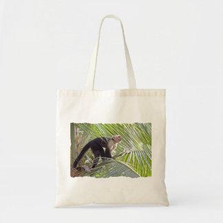 Mono en la foto de bambú de la selva bolsa de mano