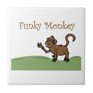 Mono enrrollado azulejos