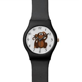 Mono exhausto del dibujo animado de Brown que Relojes