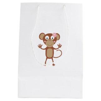 mono femenino con la flor bolsa de regalo mediana