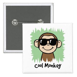 Mono fresco del clip art del dibujo animado con pin cuadrado