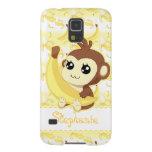 Mono lindo de Kawaii que sostiene el plátano