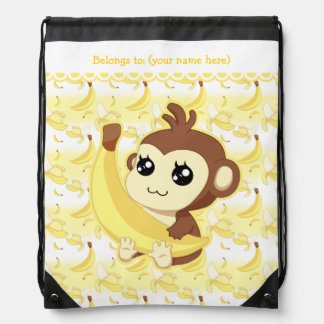 Mono lindo de Kawaii que sostiene el plátano Mochilas