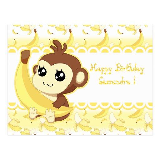 Mono lindo de Kawaii que sostiene el plátano Postales