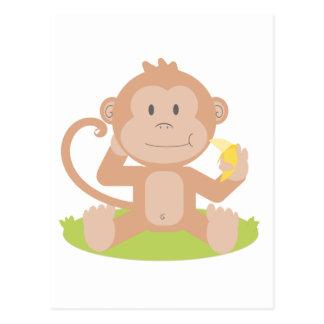 Mono lindo del bebé del dibujo animado que sienta postal