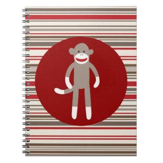 Mono lindo del calcetín en rayas rojo marrón del c libreta