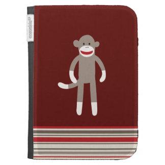 Mono lindo del calcetín en rojo con las rayas