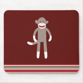 Mono lindo del calcetín en rojo con las rayas alfombrillas de ratón