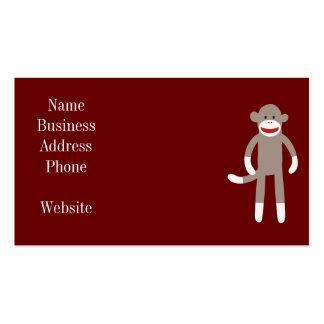 Mono lindo del calcetín en rojo con las rayas tarjetas de visita