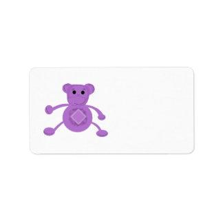 Mono púrpura del dibujo animado etiquetas de dirección