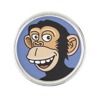 Mono sonriente del dibujo animado pin