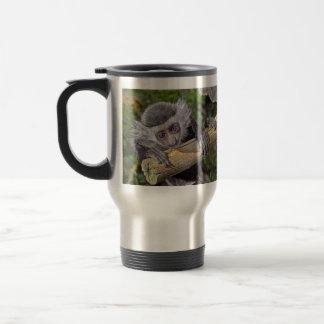 Mono - taza del viaje del bebé del mono de Colobus
