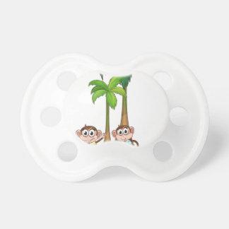 Mono y árbol chupetes de bebé