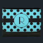 """Monogram and Polka Dot Custom Wallet<br><div class=""""desc"""">Stylish lady&#39;s black wallet, with a turquoise blue and black polka dot pattern, on the front flap. A black band runs across the middle of the flap, with a turquoise circle in the center with a one letter black monogram. Personalize the letter to suit your needs. Makes a great gift...</div>"""