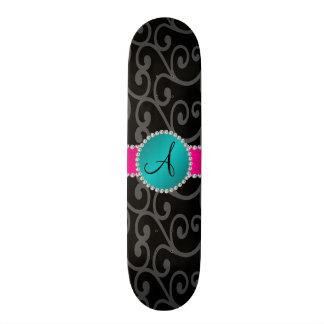 Monogram black swirls turquoise circle skate decks