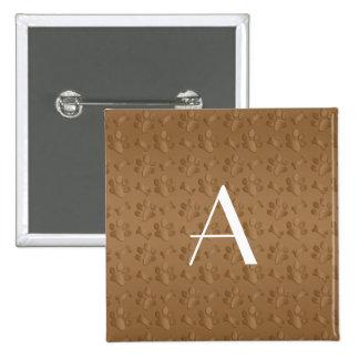 Monogram brown dog paw prints pinback button