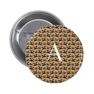 Monogram brown skulls pattern button