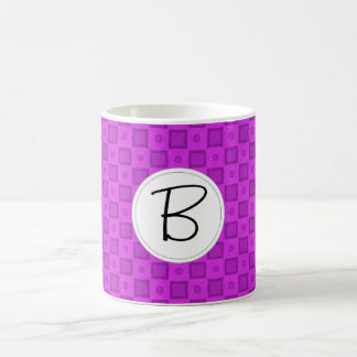 Monogram circles and squares on a purple pattern coffee mug