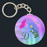"""Monogram D Flower Butterfly Keychain<br><div class=""""desc"""">Monogram letter D on a pastel background with blue flowers and a pink butterfly. Choose the letter desired. Customize letter size and/or color.</div>"""
