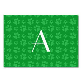 Monogram green dog paw prints table card
