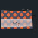 "Monogram Navy Blue Orange Chic Polka Dot Pattern Wristlet Wallet<br><div class=""desc"">Monogram Navy Blue Orange Chic Polka Dot Pattern. Trendy, fun, cute, girly, stylish, modern navy blue and orange polka dot pattern with orange polka dots against a navy blue background. The design includes a transparent white sash that can be customized with your monogram or name. Personalize it further by adding...</div>"