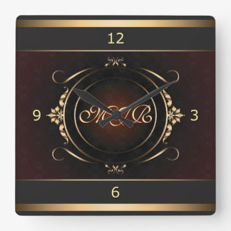 Monogram on royal burgundy, gold-flourished square wall clock
