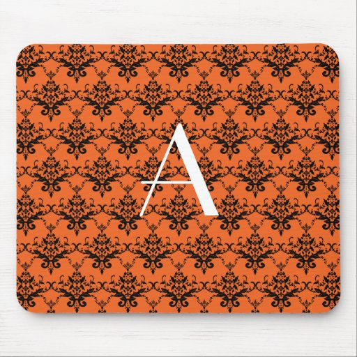 Monogram orange damask mousepads